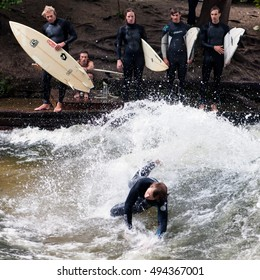 MUNICH, GERMANY   MAY 24, 2011: A Group Of Surfers Watching Their Fellow