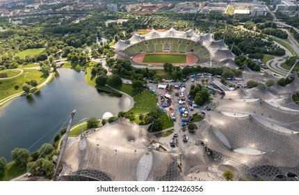 MUNICH, GERMANY - MAY 25, 2018: Aerial view on the Olympic stadium, arena and swimming hall and Olympic park in Munich. The architacture is famous for its revolutionary tentlike roof.