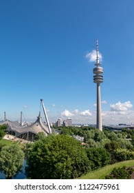 MUNICH, GERMANY - MAY 25, 2018: Munich TV tower and the Olympic swim hall on a beautiful late spring day. The 1972 Olympic games were held here.