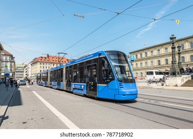 Munich, Germany - May 29, 2016: An electric tram passing around National Theatre (Residenztheater) in Munich, Germany