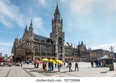 Munich, Germany - May 29, 2016: Tour guides are waiting for tourists near New Town Hall at Marienplatz Square in Munich, Bavaria, Germany.