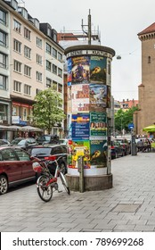 Munich, Germany - May 29, 2016: Advertising columns or Morris columns with placards on the street in the Old Town of Munich, Bavaria, Germany.