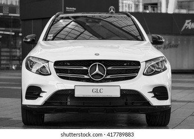 Munich, Germany - May 6, 2016: New model of elegant Mercedes-Benz GLC second generation crossover SUV. Black and white outdoor stock photo was captured in a public place with free access.