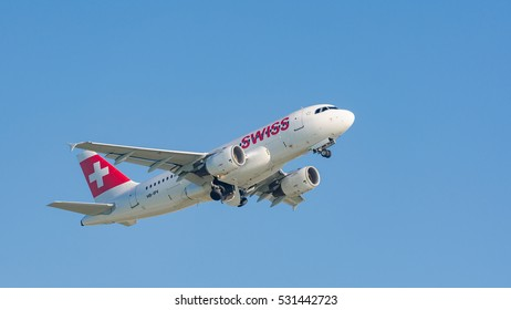 Munich, Germany - May 6, 2016: Plane Airbus A319-112 of Swiss International Air Lines flag carrier take off from Munich international airport and gains altitude