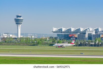 Munich, Germany - May 6, 2016: Munich international airport panoramic view with passenger airplane of Austrian Airlines taxiing to runway