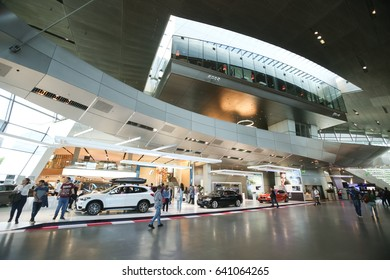 MUNICH, GERMANY - MAY 6, 2017 : People sightseeing the exhibited BMW automobile in the BMW Welt exhibition center in Munich, Germany.