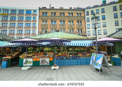MUNICH, GERMANY - MAY 9, 2017 : A fruit and vegetable food stand at the outdoor food market near Marienplatz in Munich, Germany.