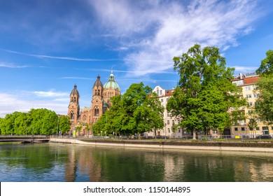 Munich Germany (Munchen), city skyline at Saint Lukas Church and Isar River