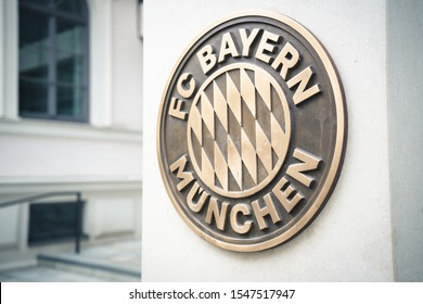 Munich, Germany - Nov. 1, 2019: Sign of high class german soccer club FC Bayern Munich playing in Champions League on urban street wall