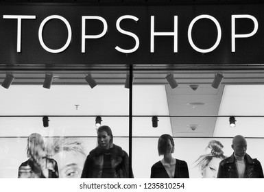 Munich, Germany - November, 2018: TOPSHOP logo and window display of a department store. TOPSHOP is a British multinational fashion retailer and company chain of clothing, shoes, make-up and accessory