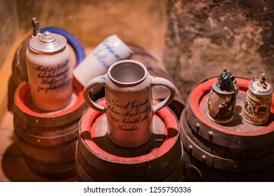 MUNICH, GERMANY - NOVEMBER 24, 2018 : Expositions at the Museum of the Oktoberfest festival mugs, bottles history of celebration.