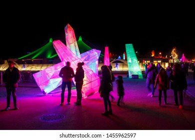 Munich, Germany - November 30, 2016: Tollwood winter festival in Munich during the evening hours with illuminated decoration