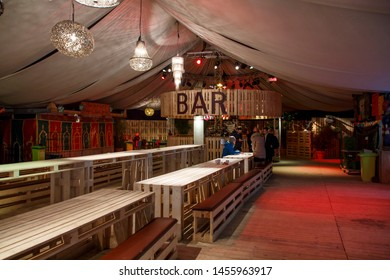Munich, Germany - November 30, 2016: Tollwood winter festival and christmas market in Munich during the evening hours inside a tent