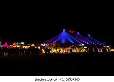 Munich, Germany - November 30, 2016: Tollwood winter festival and christmas market in Munich during the evening hours with illuminated tents and bars