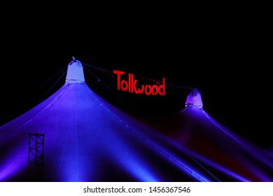Munich, Germany - November 30, 2016: Tollwood winter festival in Munich during the evening hours with the Tollwood sign on top of a tent