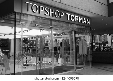 Munich, Germany - November,2018: TOPSHOP TOPMAN logo and window display of a department store for men. TOPSHOP is a British fashion retailer and company chain of clothing, shoes, make-up and accessory