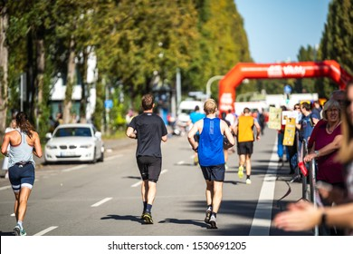 Munich, Germany - Oct. 13, 2019: Marathon runners in central Munich supported by the crowed running a 42 kilometer endurance race