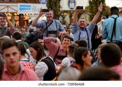 MUNICH, GERMANY - OCT 2, 2017: Unidentified men at the Octoberfest,  the world's largest festival