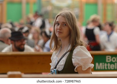MUNICH, GERMANY - OCT 2, 2017: Unidentified girl in traditional Bavarian costume at the Octoberfest,  the world's largest festival