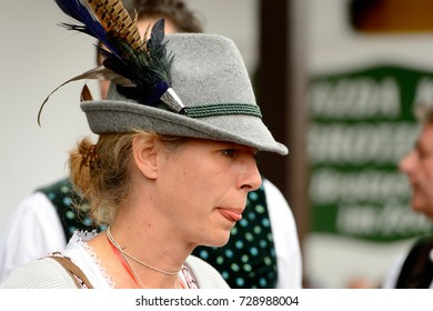 MUNICH, GERMANY - OCT 2, 2017: Unidentified girl in traditional Bavarian hat at the Octoberfest,  the world's largest festival