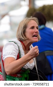 MUNICH, GERMANY - OCT 2, 2017: Unidentified woman in traditional Bavarian costume at the Octoberfest,  the world's largest festival