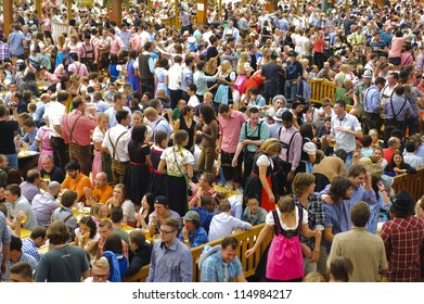 """MUNICH, GERMANY - OCT 3: beer tent with dancing people at world biggest beer festival """"Oktoberfest in Munich"""" on October 3, 2012 in Munich, Germany"""
