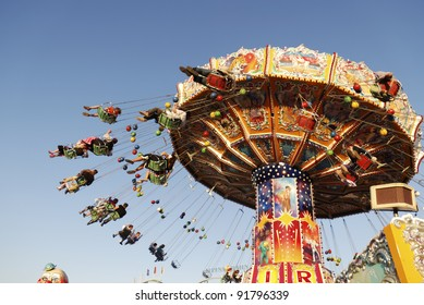 MUNICH, GERMANY - OCT 3: Chairoplane on the Oktoberfest in Munich, Germany on October 3, 2011. The Oktoberfest is the biggest beer festival of the world with over 6 million visitors each year.