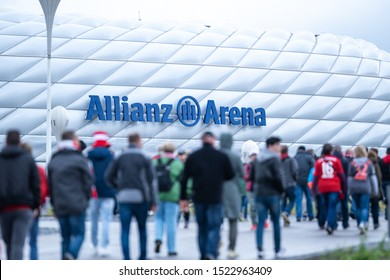 Munich, Germany - Oct. 5, 2019: Fans of famous football soccer club FC Bayern München playing in german bundesliga and champions league walking to Allian Arena home stadium for match time