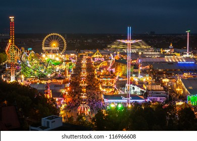 MUNICH, GERMANY - OCTOBER 1: View of the Oktoberfest in Munich, Germany at night on October 1, 2012. Oktoberfest is a festival celebrating beer in Munich.