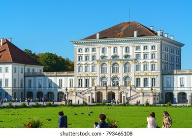 MUNICH, GERMANY - OCTOBER 14, 2017: Tourists walking in front of the Nymphenburg Palace