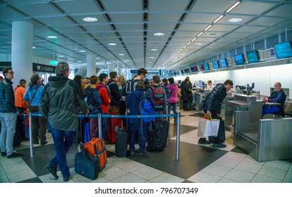 Munich, Germany - October 14, 2017: Passengers stand in line for check-in and transfer baggage