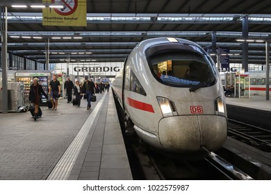 MUNICH, GERMANY - OCTOBER 15, 2017: People and arriving high speed train Munich main station, Germany