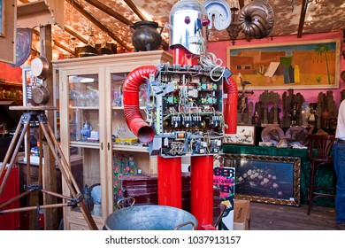 MUNICH, GERMANY - OCTOBER 17, 2017  - Rarities and curiosities at the Auer Dult, one of Munich's oldest flea markets, booth with a funny vintage robot, made with stove pipes painted in red