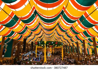 Munich, Germany - October 2, 2014: People drinking in the Hippodrome Beer Tent on the Theresienwiese Oktoberfest fair grounds