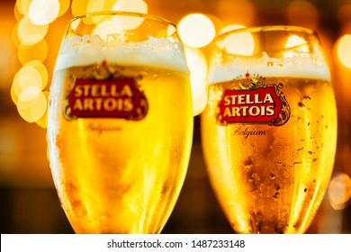 Munich, Germany- October 2, 2018:Cold glass of Stella Artois beer on a light bokeh background