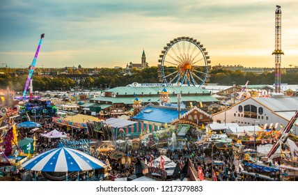 Munich, Germany - October 7: people and fairground rides at the biggest folk festival in the world - the oktoberfest on oktober 7, 2018 in munich.