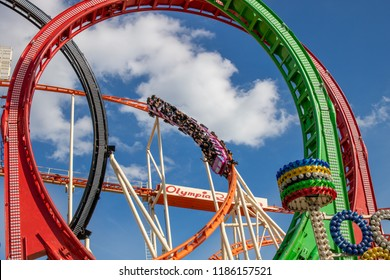 Munich, germany, oktoberfest - Sept 22 2018: Rollercoaster OLYMPIA LOOPING on the oktoberfest in munich with blue sky