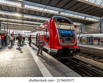 Munich, Germany, on August 16, 2018. The train at the platform of the central railway station (Munchen Hauptbahnhof). Passengers go to cars