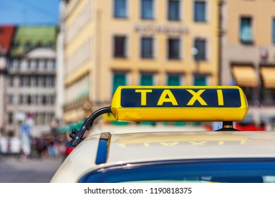 Munich, Germany, on August 16, 2018. The taxi on the city street against the background of an architectural complex