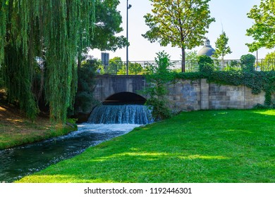Munich, Germany, on August 22, 2018. The English garden - one of city parks. The beautiful bridge through an artificial stream