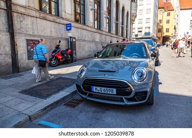 Munich, Germany, on August 22, 2018. Beautiful city street. Cars are parked along the sidewalk