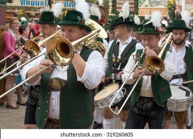 MUNICH, GERMANY - SEPT. 20, 2015: Traditional Marching Bands entertain Crowds of visitors at the annual Oktoberfest. The Festival runs from September 19th until October 4th 2015 in Munich, Germany