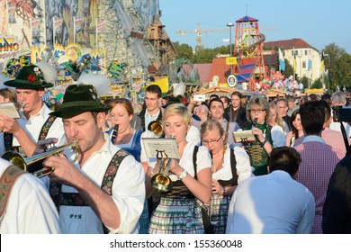MUNICH, GERMANY - SEPT. 21, 2013: Traditional Marching Band entertains Crowds of visitors at the annual Oktoberfest..   The Festival runs from Sept. 21 - Oct. 6  in Munich, Germany