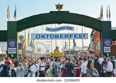 MUNICH, GERMANY - SEPT. 21, 2013: Crowds of visitors at the annual Oktoberfest celebrating the opening day.   The Festival runs from Sept. 21 - Oct. 6  in Munich, Germany