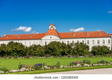 MUNICH, GERMANY - SEPT 8, 2018: Nymphenburg Palace (Schloss Nymphenburg - Castle of the Nymphs) with the clock tower. The palace was the main summer residence of the former rulers of Bavaria