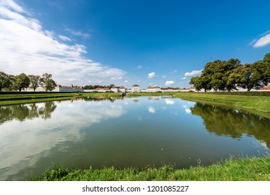 MUNICH, GERMANY - SEPT 8, 2018: Nymphenburg Palace (Schloss Nymphenburg - Castle of the Nymphs) with the lake or pond. The palace was the main summer residence of the former rulers of Bavaria