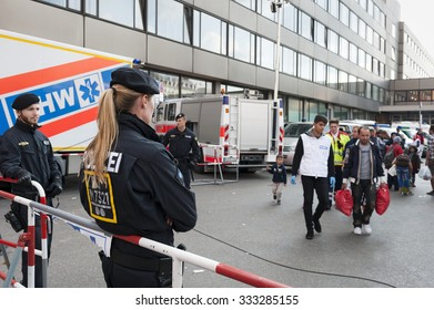 Munich, Germany - September 10, 2015: German police and helpers are waiting for the next queue of refugees from Syria, Afghanistan and Balkan countries.