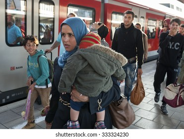Munich, Germany - September 10, 2015: Mother and daughter from Syria in Munich. The registration area at the Munich central station is well organized to manage also large amounts of arriving refugees
