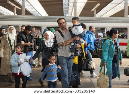 Munich, Germany - September 10, 2015: Refugees from Syria, Afghanistan and Balkan countries hopping on the next train at the main station in Munich.