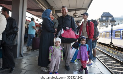 Munich, Germany -September 10th, 2015: Refugees from Syria hopping on the next train at the main station in Munich.